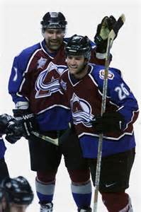 Yelle celebrates a goal with Ray Borque's dad...oh wait, that's Ray Borque. Holy crap.